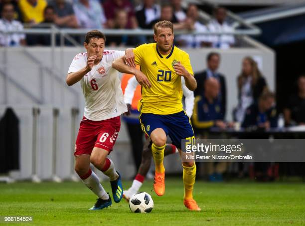 Andreas Christensen of Denmark and Ola Toivonen of Sweden competes for the ball during the International Friendly match between Sweden and Denmark at...