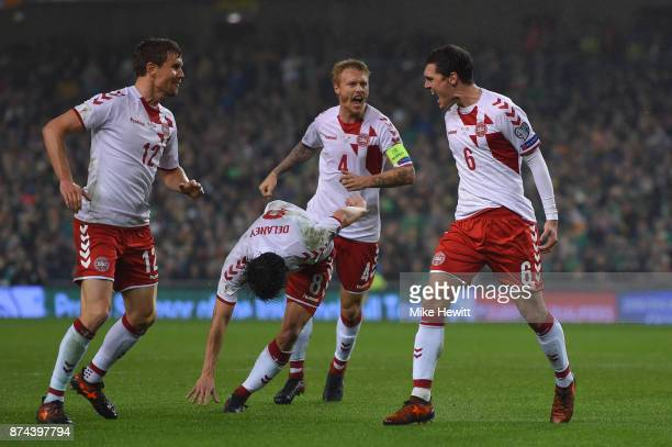 Andreas Christensen of Denmark celebrates with team mates Andreas Bjelland Thomas Delaney and Simon Kjaer after scoring during the FIFA 2018 World...