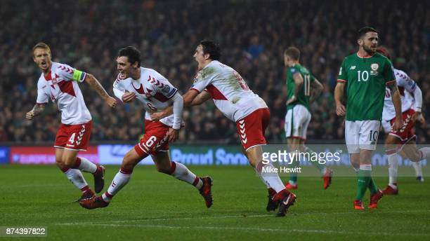 Andreas Christensen of Denmark celebrates with team mates Simon Kjaer and Thomas Delaney after scoring during the FIFA 2018 World Cup Qualifier...
