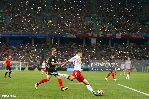 Andreas Christensen of Denmark competes with Ivan Rakitic of Croatia during the 2018 FIFA World Cup Russia Round of 16 match between Croatia and...