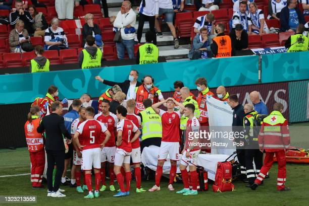 Andreas Christensen of Denmark looks dejected whilst team mate Christian Eriksen receives medical treatment during the UEFA Euro 2020 Championship...
