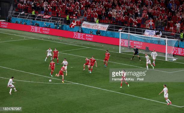 Andreas Christensen of Denmark scores their side's third goal past Matvei Safonov of Russia during the UEFA Euro 2020 Championship Group B match...