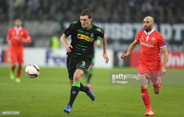 Andreas Christensen of Moenchengladbach and Borja Valero of Fiorentina battle for the ball during the UEFA Europa League Round of 32 first leg match...