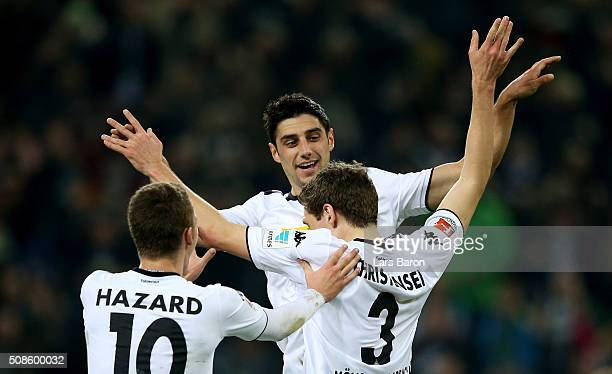 Andreas Christensen of Moenchengladbach celebrates with team mates Thorgan Hazard of Moenchengladbach and Lars Stindl of Moenchengladbach after...
