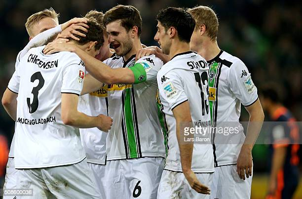 Andreas Christensen of Moenchengladbach celebrates with team mates after scoring his teams second goal during the Bundesliga match between Borussia...
