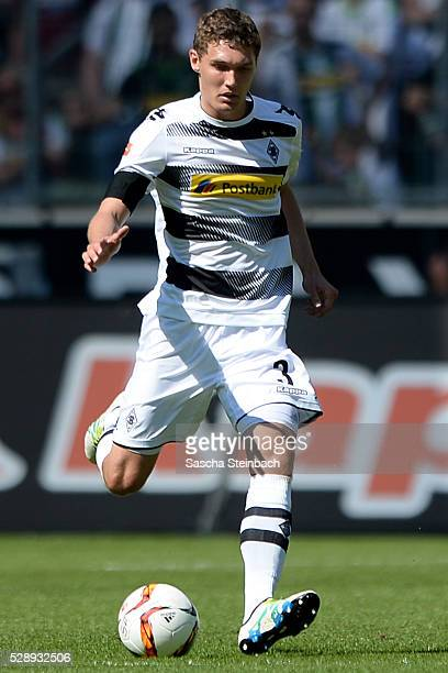 Andreas Christensen of Moenchengladbach runs with the ball during the Bundesliga match between Borussia Moenchengladbach and Bayer Leverkusen at...