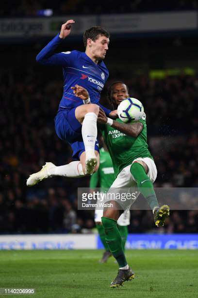 Andreas Christiansen of Chelsea is challenged by Gaetan Bong of Brighton and Hove Albion during the Premier League match between Chelsea FC and...
