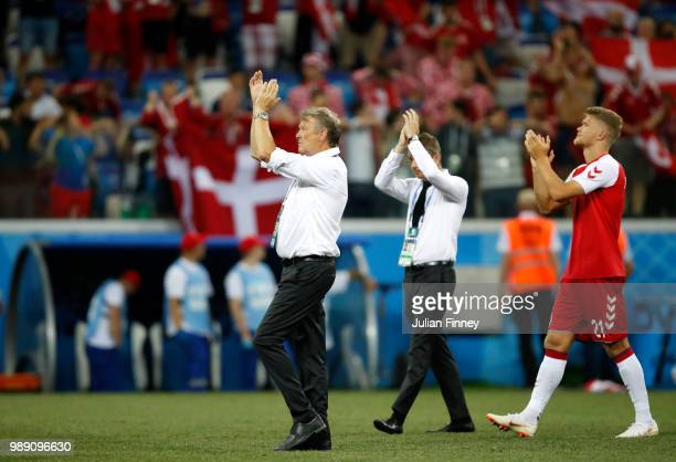 Andreas Cornelius and Age Hareide Manager of Denmark acknowledge the fans following the 2018 FIFA World Cup Russia Round of 16 match between Croatia...