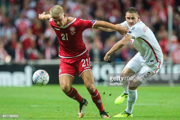 Andreas Cornelius Artur Jedrzejczyk during the FIFA 2018 World Cup Qualifier between Denmark and Poland at Parken Stadion on September 1 2017 in...
