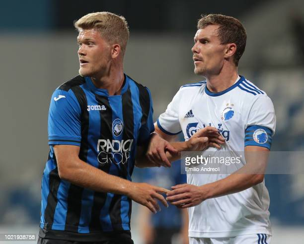 Andreas Cornelius of Atalanta BC and Andreas Bjelland of FC Copenhagen look on during the UEFA Europa League PlayOff first leg match between Atalanta...
