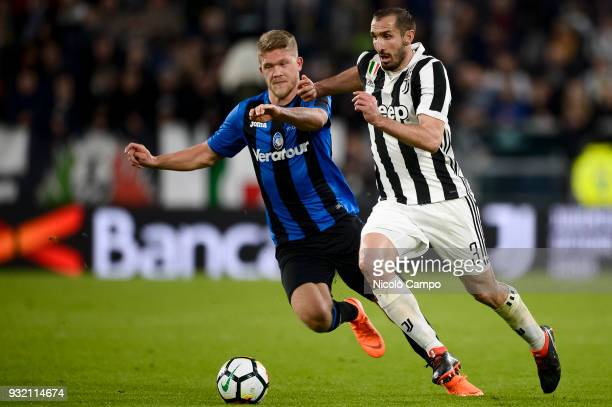 Andreas Cornelius of Atalanta BC competes for the ball with Giorgio Chiellini of Juventus FC during the Serie A football match between Juventus FC...