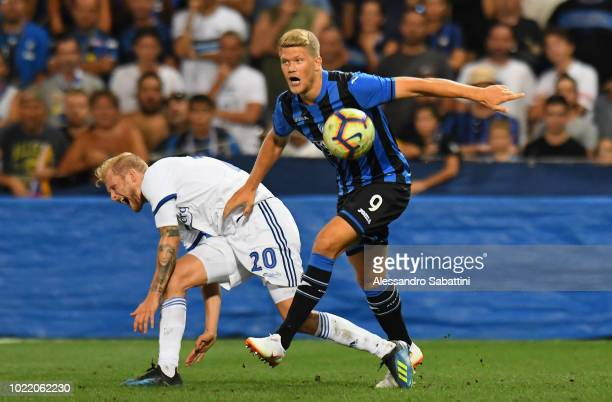 Andreas Cornelius of Atalanta BC competes for the ball with Nicolai Boilesen of FC Copenhagen during the UEFA Europa League PlayOff between Atalanta...