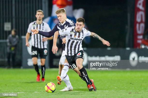Andreas Cornelius of Bordeaux and Baptiste Santamaria of Angers during the Ligue 1 match between Angers and Bordeaux at Stade Jean Bouin on January...