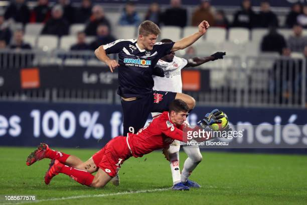 Andreas Cornelius of Bordeaux and Bobby Allain of Dijon during the Ligue 1 match between Bordeaux and Dijon at Stade Matmut Atlantique on January 20...