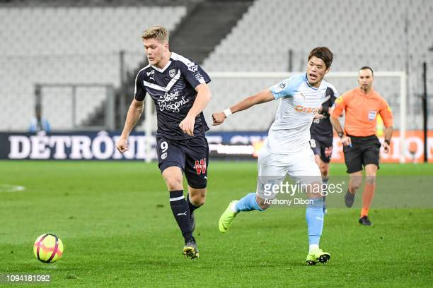 Andreas Cornelius of Bordeaux and Hiroki Sakai of Marseille during the Ligue 1 match between Marseille and Bordeaux at Stade Velodrome on February 5...