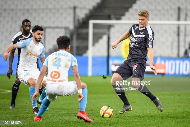 Andreas Cornelius of Bordeaux and Morgan Sanson of Marseille during the Ligue 1 match between Marseille and Bordeaux at Stade Velodrome on February 5...