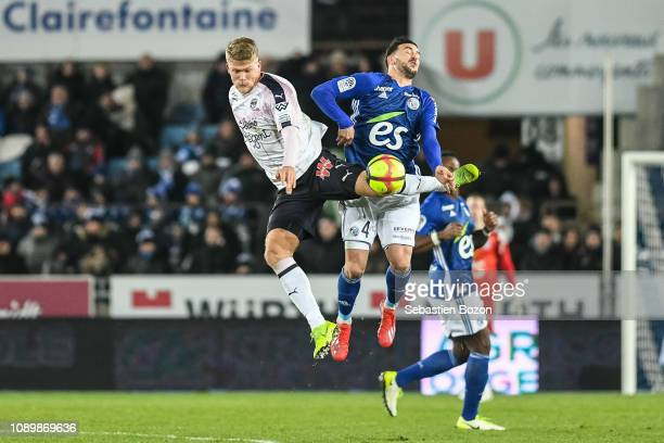 Andreas Cornelius of Bordeaux and Pablo Martinez of Strasbourg during the Ligue 1 match between Strasbourg and Bordeaux at La Meinau Stadium on...