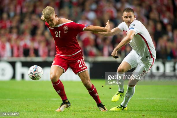 Andreas Cornelius of Denmark and Artur Jedrzejczyk of Poland during the FIFA World Cup 2018 Qualifying Round between Denmark and Poland at Telia...
