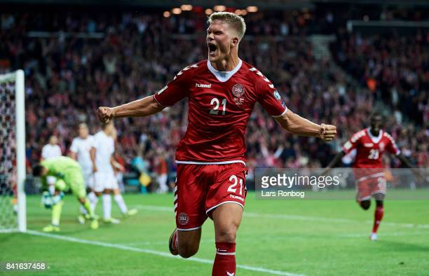 Andreas Cornelius of Denmark celebrates after scoring their second goal during the FIFA World Cup 2018 qualifier match between Denmark and Poland at...