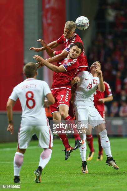 Andreas Cornelius of Denmark wins a header from Piotr ZieliÅsk of Poland and William Kvist of Denmark during the FIFA 2018 World Cup Qualifier...