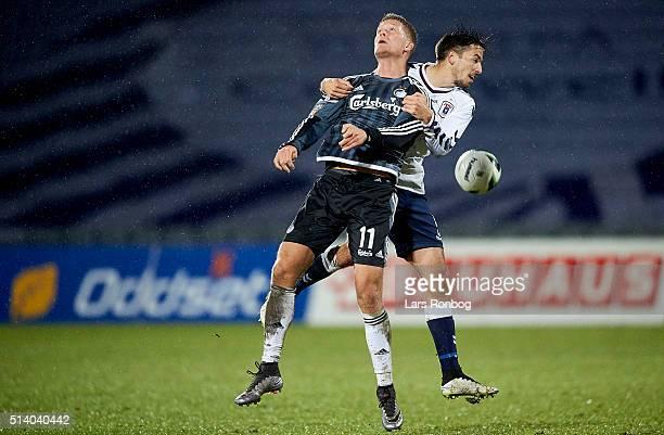 Andreas Cornelius of FC Copenhagen and Alexander Juel Andersen of AGF Aarhus compete for the ball during the Danish Alka Superliga match between AGF...
