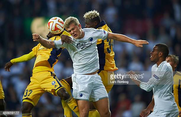 Andreas Cornelius of FC Copenhagen and Anthony Annan of HJK Helsinki compete for the ball during the UEFA Europa League match between FC Copenhagen...