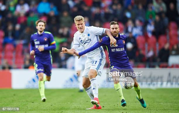 Andreas Cornelius of FC Copenhagen and $anus Drachmann of FC Midtjylland compete for the ball during the Danish Alka Superliga match between FC...