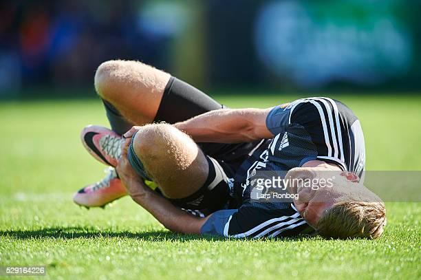 Andreas Cornelius of FC Copenhagen lies injured on the ground during the Danish Alka Superliga match between OB Odense and FC Copenhagen at TreFor...