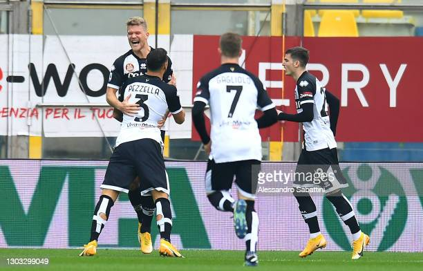 Andreas Cornelius of Parma Calcio 1913 celebrates with team mates Giuseppe Pezzella and Valentin Mihaila after scoring their side's first goal during...