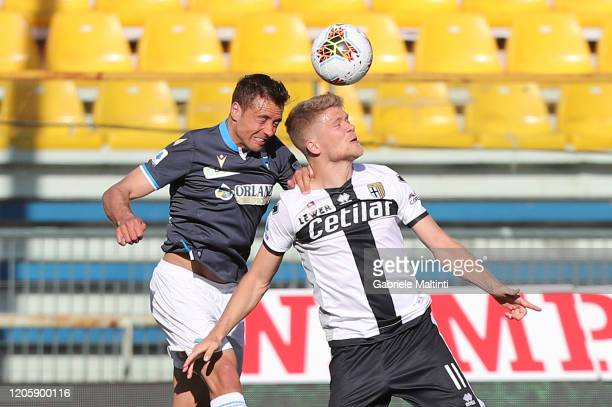 Andreas Cornelius of Parma Calcio battles for the ball with Thiago Cionek of SPAL during the Serie A match between Parma Calcio and SPAL at Stadio...