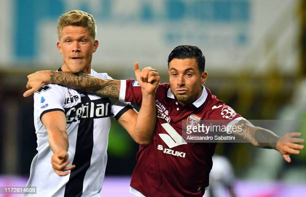 Andreas Cornelius of Parma Calcio competes for the ball with Armando Izzo of Torino FC during the Serie A match between Parma Calcio and Torino FC at...