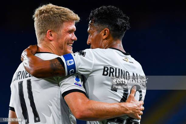 Andreas Cornelius of Parma celebrates with Bruno Alves after scoring his second goal during the Serie A match between Genoa CFC and Parma Calcio at...