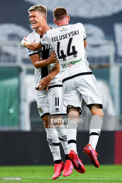 Andreas Cornelius of Parma celebrates with Dejan Kulusevski after scoring a goal during the Serie A match between Genoa CFC and Parma Calcio at...