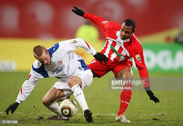 Andreas Dahlen of Rostock battles for the ball with Mohammed Lartey of Ahlen during the Second Bundesliga match between FC Hansa Rostock and RotWeiss...