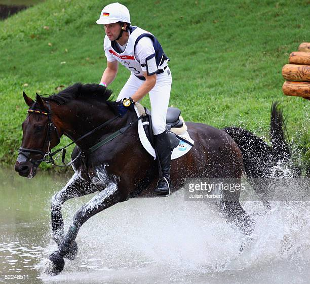 Andreas Dibowski of Germany and Butts Leon go through the water jump during the Cross Country section of the Equestrian event at the Beas River...