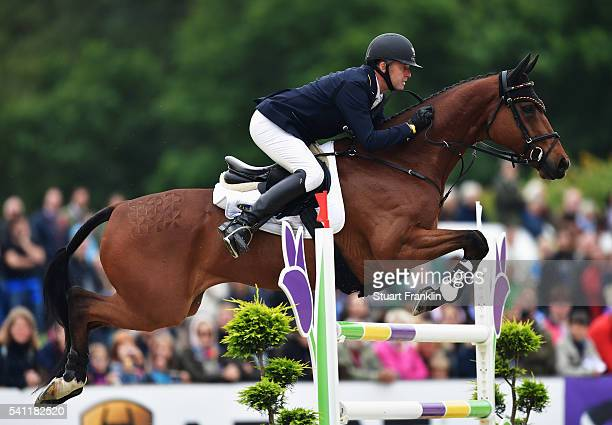 Andreas Dibowski of Germany riding It's Me jumps during th show jumoing section of Messmer Trophy Luhmuhlen on June 19 2016 in Luhmuhlen Germany