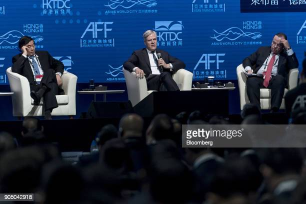 Andreas Dombret board member of Deutsche Bundesbank center speaks as Hu Huaibang chairman of China Development Bank left and Stuart Gulliver outgoing...