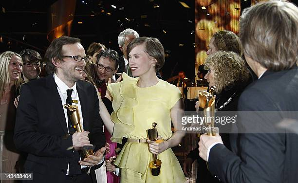Andreas Dresen Alina Levshin and Milan Peschel pose with their Awards at the Lola German Film Award 2012 Show at FriedrichstadtPalast on April 27...