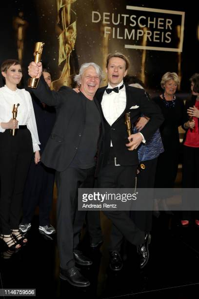 Andreas Dresen, winner of the best directing award, and Alexander Scheer, winner of male leading role award, pose during the Lola - German Film Award...