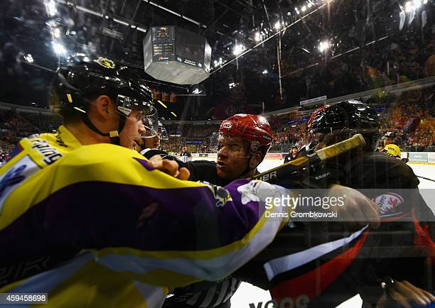 Andreas Driendl of Krefeld Pinguine and Shawn Belle of Duesseldorfer EG fight during the DEL Ice Hockey match between Duesseldorfer EG and Krefeld...