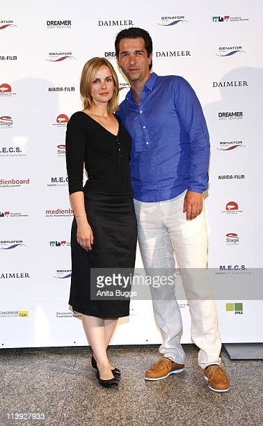 Andreas Elsholtz and Denise Zich attend the 'Geliebtes Leben' Germany premiere at the Theater am Potsdamer Platz on May 10 2011 in Berlin Germany