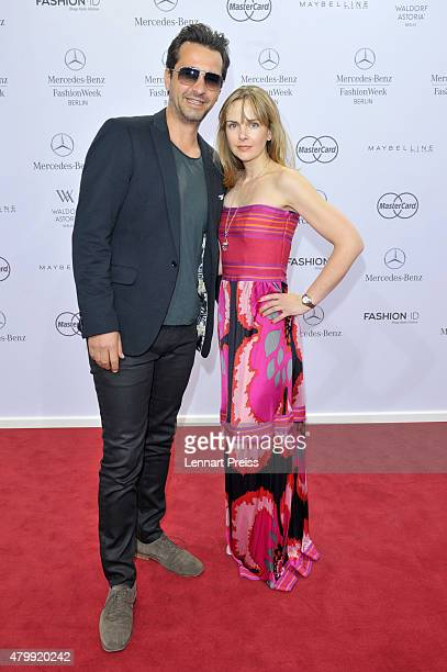 Andreas Elsholz and Denise Zich attend the Irene Luft show during the MercedesBenz Fashion Week Berlin Spring/Summer 2016 at Brandenburg Gate on July...