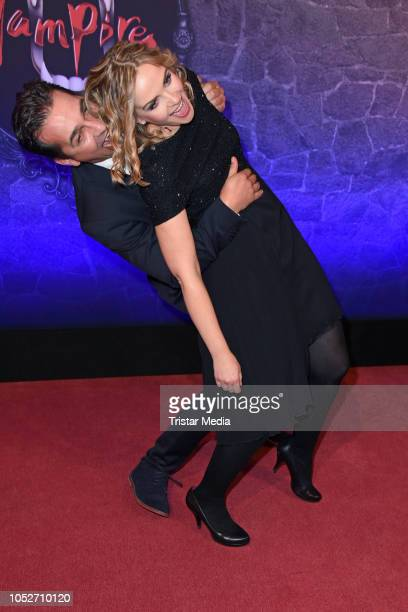 Andreas Elsholz and his wife Denise Zich attend the musical premiere of 'Tanz der Vampire' at Theater des Westens on October 21 2018 in Berlin Germany