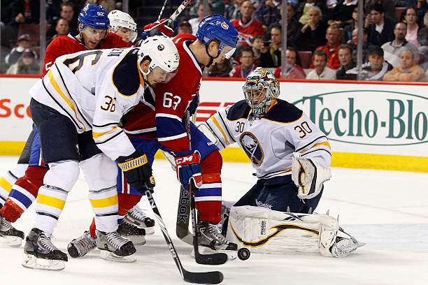 765dbdcdf Andreas Engqvist  63 of the Montreal Canadiens and Ryan Miller  30 of the  Buffalo