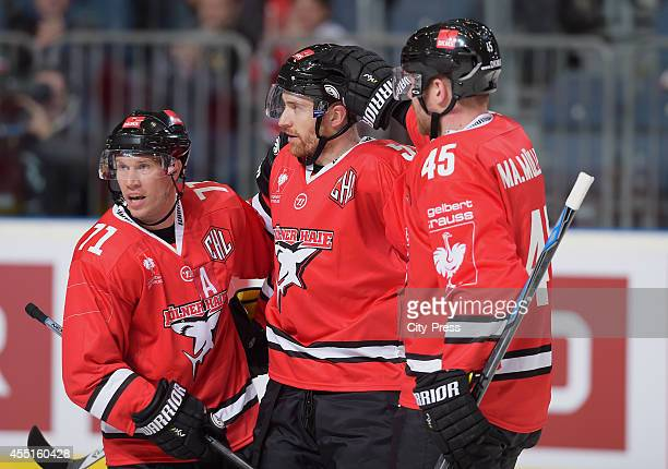 Andreas Falk Alexander Sulzer and Marcel Mueller of Koelner Haie celebrate during the Champions Hockey League game between Koelner Haie and HC Kosice...