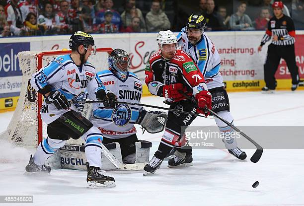 Andreas Falk Koeln and Tyler John Bouck of Ingolstadt battle for the puck in game one of the DEL final playoffs between Koelner Haie and ERC...