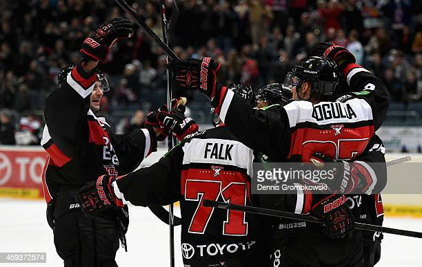 Andreas Falk of Koelner Haie celebrates as he scores the second goal during the DEL Ice Hockey match between Koelner Haie and Hamburg Freezers at...