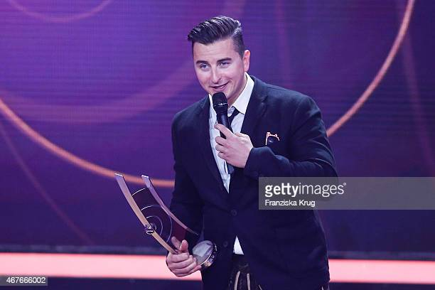 Andreas Gabalier accepts the award in the category 'Volkstuemliche Musik' at the Echo Award 2015 show on March 26 2015 in Berlin Germany