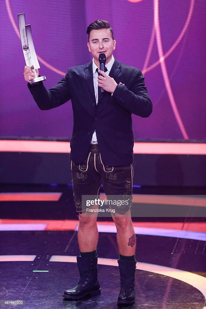 Andreas Gabalier accepts the award in the category 'Volkstuemliche Musik' at the Echo Award 2015 show on March 26, 2015 in Berlin, Germany.