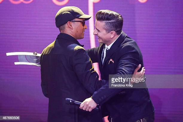 Andreas Gabalier accepts the award in the category 'Volkstuemliche Musik' from Xavier Naidoo at the Echo Award 2015 show on March 26 2015 in Berlin...